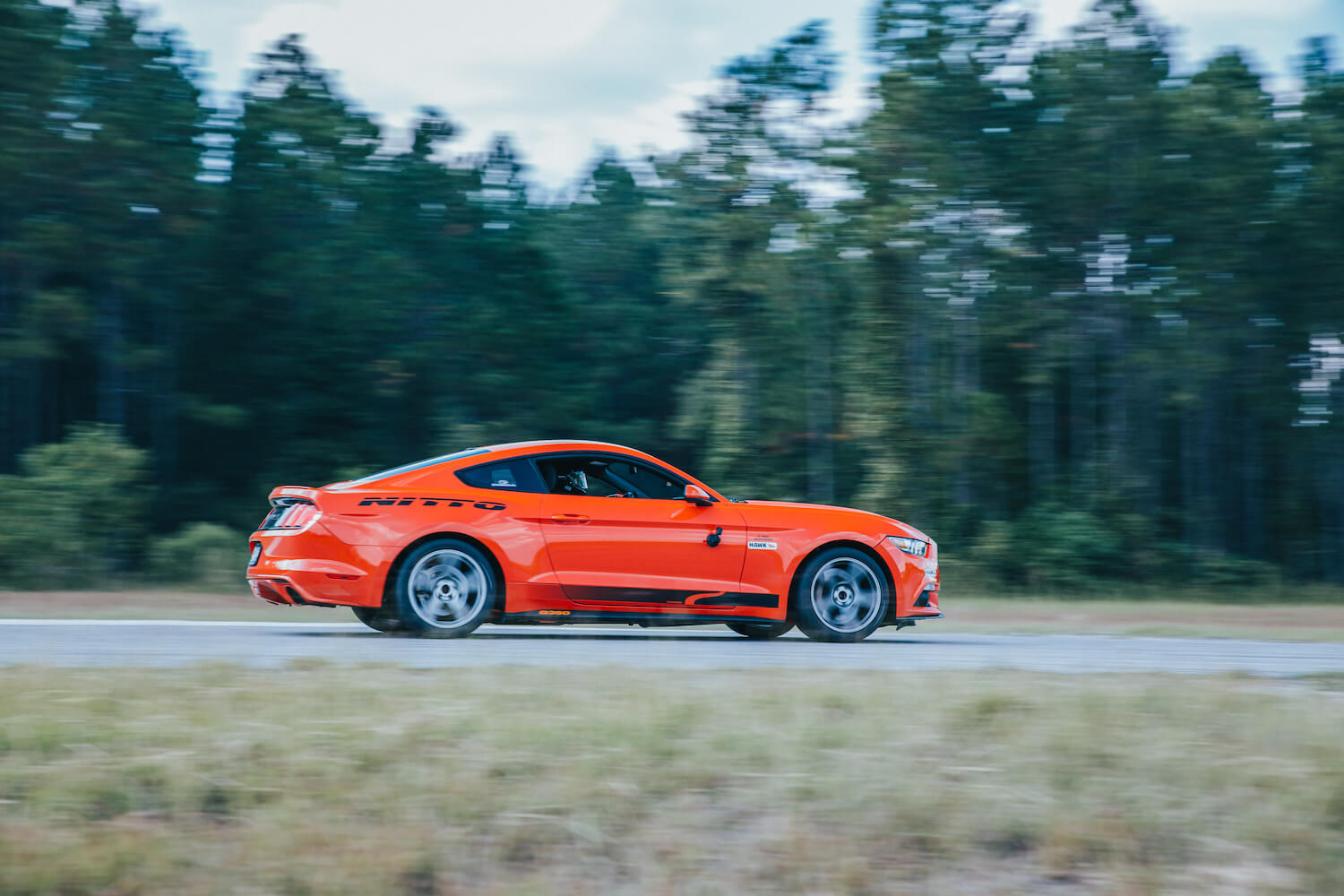 Competition Orange Mustang On Track