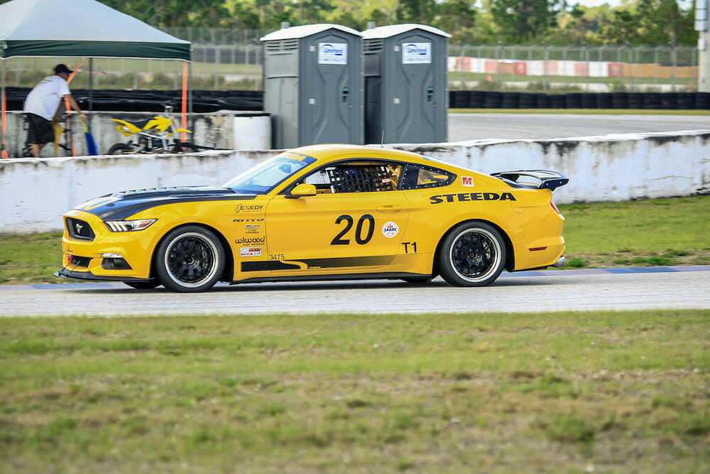Steeda Yellow #20 Race Car On Track
